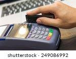 hand swiping credit card in...   Shutterstock . vector #249086992