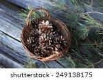 Wicker Basket With Pine Cones