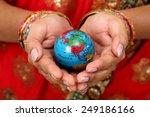 woman holding globe on her hands | Shutterstock . vector #249186166
