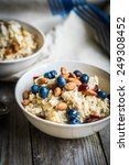 oatmeal with berries and nuts | Shutterstock . vector #249308452
