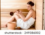 young woman in white towel... | Shutterstock . vector #249386002