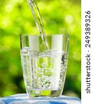 glass of water on nature... | Shutterstock . vector #249389326