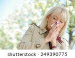 senior woman blowing her nose... | Shutterstock . vector #249390775