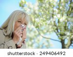 Senior Woman Blowing Her Nose...