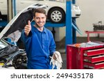 Smiling Mechanic Looking At...