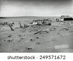 Small photo of Buried machinery in a barn lot in Dallas, South Dakota in 1936. The Dust Bowl ecological disaster extended from Texas into the Northern Plains and Canada.