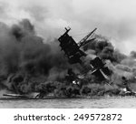 The battleship USS ARIZONA sinking after being hit by Japanese air attack on Dec. 7, 1941.