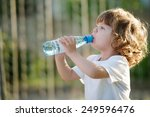 little beautiful girl drinking... | Shutterstock . vector #249596476