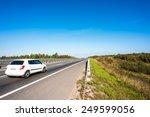 White Car Traveling Away On...