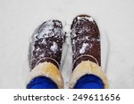 brown winter boots in the snow | Shutterstock . vector #249611656
