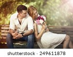 Stock photo love and celebrate concept young beautiful couple sitting in the park and man proposing woman 249611878