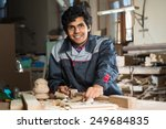 young craftsman in uniform... | Shutterstock . vector #249684835