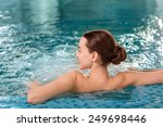 Young Woman Enjoying Jacuzzi I...