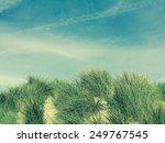 sand dune against bue sky | Shutterstock . vector #249767545