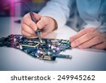 tech fixes motherboard in... | Shutterstock . vector #249945262