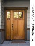 natural wood front door on grey ... | Shutterstock . vector #249954046