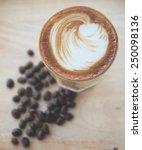 hot espresso with latte art | Shutterstock . vector #250098136