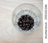 coffee beans in glass | Shutterstock . vector #250102186