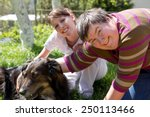 two women and a half breed dog... | Shutterstock . vector #250113466