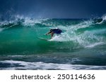 surfer riding in the barrel.... | Shutterstock . vector #250114636