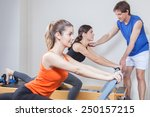 two girls exercising in pilates | Shutterstock . vector #250157215
