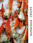 Small photo of Cooked Alaska King Crab Legs on ice for sale at a public market