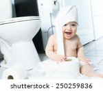 Toddler Ripping Up Toilet Pape...