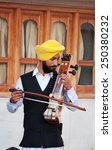 Small photo of AMRITSAR, INDIA, DEC - 7, 2014: Indian musician playing sarangi at Golden Temple (Harmandir Sahib also Darbar Sahib). Golden Temple is the holiest Sikh gurdwara located in the city of Amritsar