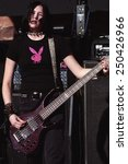 Small photo of DENVER MAY 01: Bassist Talena Atfield of the Alternative Rock band Kittie performs in concert May 11, 2001 at Red Rocks Amphitheater in Denver, CO.