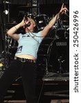 Small photo of DENVER MAY 01: Vocalist/Guitarist Morgan Lander of the Alternative Rock band Kittie performs in concert May 11, 2001 at Red Rocks Amphitheater in Denver, CO.