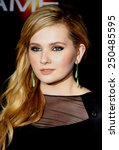 """Small photo of Abigail Breslin at the Los Angeles Premiere of """"Ender's Game"""" held at the TCL Chinese Theater in Hollywood, USA on October 28, 2013."""