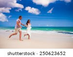happy couple running at the... | Shutterstock . vector #250623652