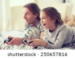 child playing video game on tv... | Shutterstock . vector #250657816