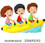 happy kids riding a banana boat | Shutterstock . vector #250693192