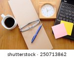 note book and black coffee on... | Shutterstock . vector #250713862