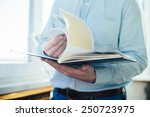 closeup on a man reading a... | Shutterstock . vector #250723975