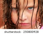 a very grumpy young girl with... | Shutterstock . vector #250800928