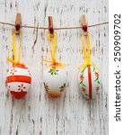 easter eggs hanging on a line... | Shutterstock . vector #250909702
