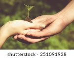 man and woman holding young... | Shutterstock . vector #251091928