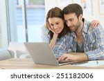couple at home websurfing on... | Shutterstock . vector #251182006