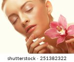beautiful girl with orchid... | Shutterstock . vector #251382322