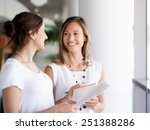 two female collegues standing... | Shutterstock . vector #251388286