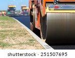 Road Roller Compacting Asphalt...