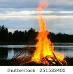 a big fire at a lake shore on...   Shutterstock . vector #251533402