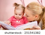 happy mother read a book to... | Shutterstock . vector #251541382