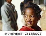 Stock photo smiling poor african girl madagascar 251550028