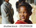 Stock photo smiling poor african girl madagascar 251550028