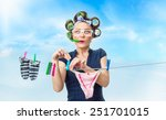 Stock photo woman hanging wet clothing with clothespin on clothes line outdoor outside 251701015