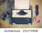Stock photo vintage typewriter and vintage camera and coffee on the wood background vintage color tone 251774908