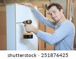 a carpenter working hard at the ... | Shutterstock . vector #251876425